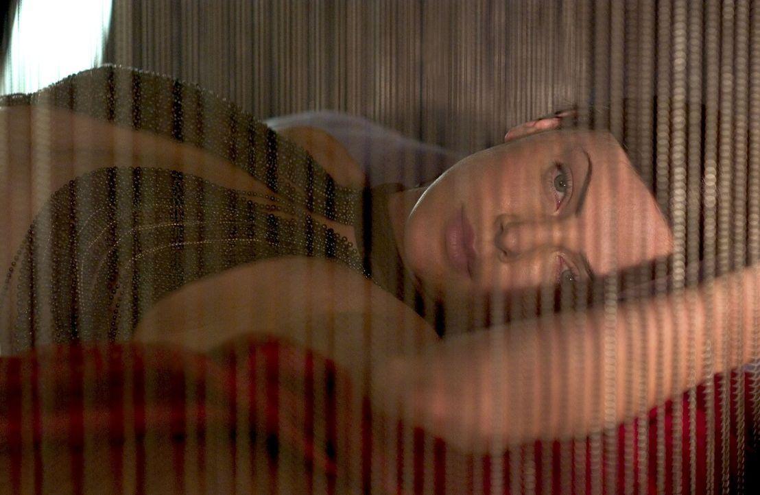 Aeon Flux (Charlize Theron) lebt ein perfektes Leben in perfekter Harmonie, doch dann werden ihre Eltern von Regierungsagenten ermordet und ihre Sch... - Bildquelle: 2004 by PARAMOUNT PICTURES. All Rights Reserved.