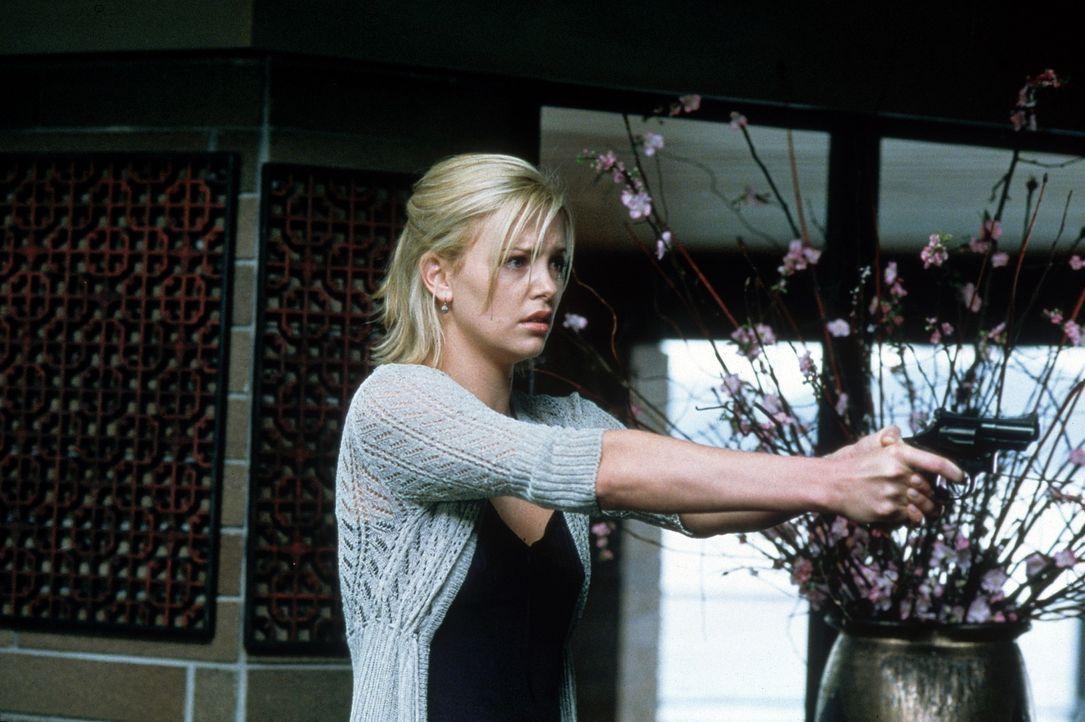 Für Joe, Cheryl und Marvin war es der perfekte Plan, doch Karen (Charlie Theron) versucht alles, um ihre Tochter lebend zurückzubekommen ... - Bildquelle: Senator Film