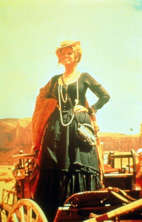 Als die junge Witwe (Claudia Cardinale) erfährt, dass ihr Mann beim Bau einer Bahnlinie im Wege stand, tritt sie trotzig sein Erbe an ... - Bildquelle: Paramount Pictures