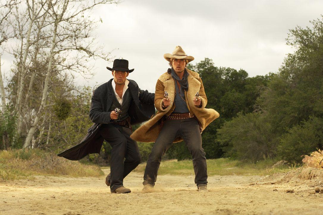 Ende des 19. Jahrhunderts sind Butch Cassidy (David Clayton Rogers, l.) und Sundance Kid (Ryan Browing, r.) ebenso berühmt wie berüchtigt.