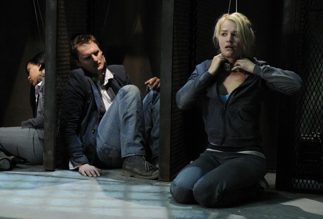 Erst viel zu spät geht den Teilnehmern (v.l.n.r.: Meagan Good, Greg Bryk, Laura Gordon) des mörderischen Spiels auf, dass sie nur gemeinsam eine Übe... - Bildquelle: 2007 Lionsgate, Twisted Pictures