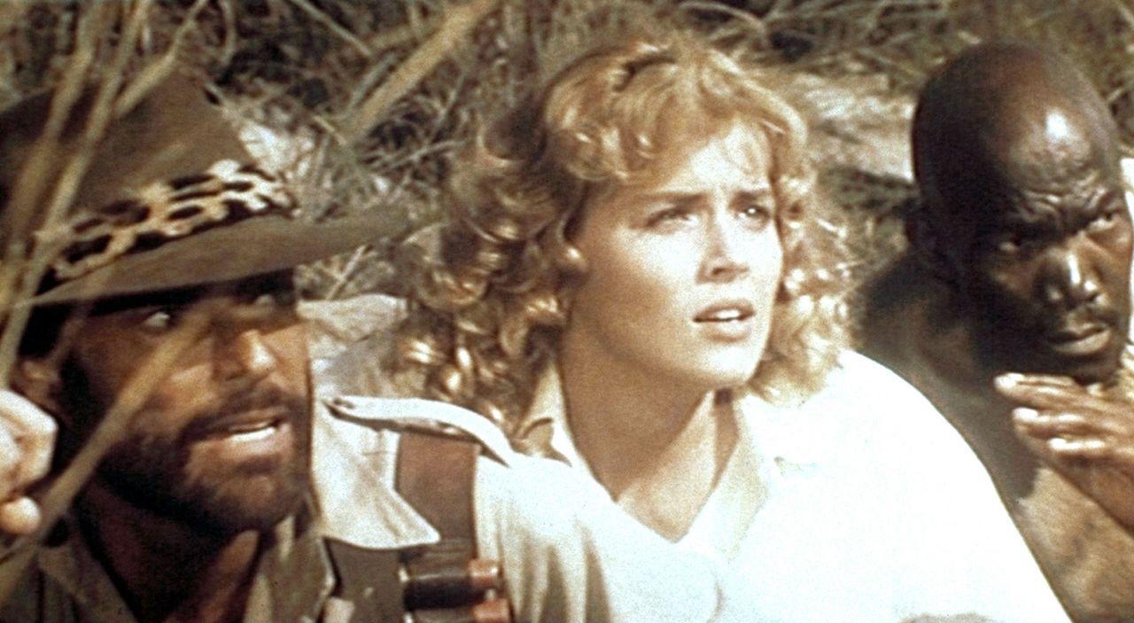 Quartermain (Richard Chamberlain, l.), Jessie (Sharon Stone, M.) und Umbopo (Ken Gampu, r.) auf der Suche nach dem Schatz des Königs Salomon ... - Bildquelle: Cannon Group