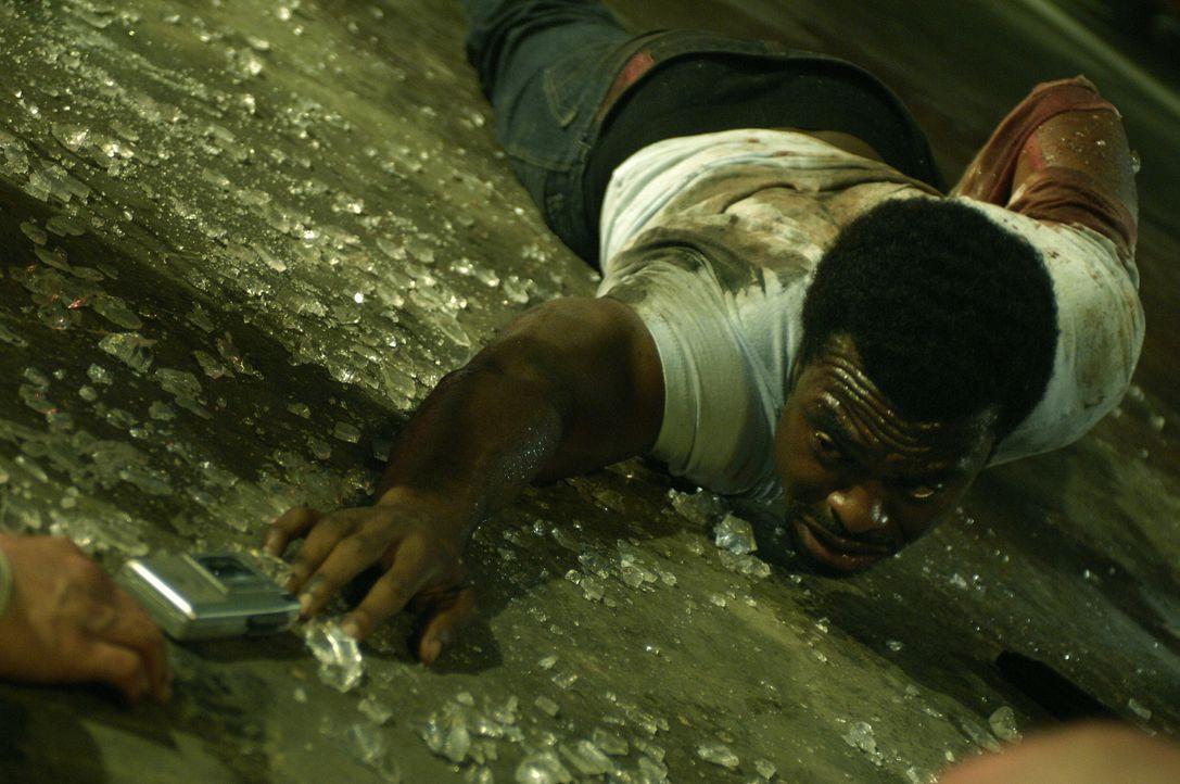 Versucht alles, um seine Kollegen zu retten: SWAT-Commander Rigg (Lyriq Bent) ... - Bildquelle: 2007 Lionsgate, Twisted Pictures