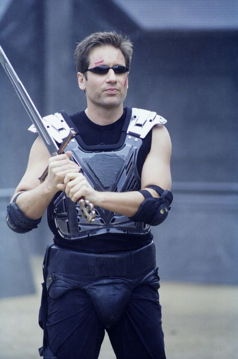 Mulder (David Duchovny) begibt sich in die virtuelle Welt des Computerspiels. Auch dort versucht er mit aller Kraft, das Böse zu bekämpfen. - Bildquelle: TM +   2000 Twentieth Century Fox Film Corporation. All Rights Reserved.