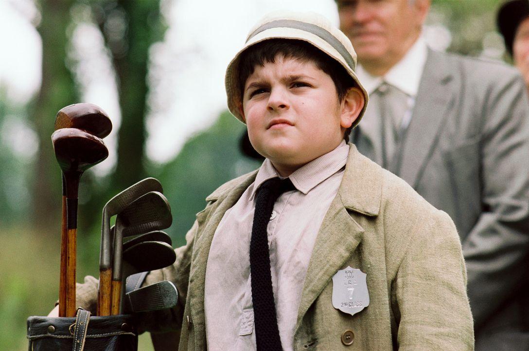Der gewitzte zehnjährige Eddie Lowery (Josh Flitter) gibt als Caddy alles ... - Bildquelle: Walt Disney Pictures